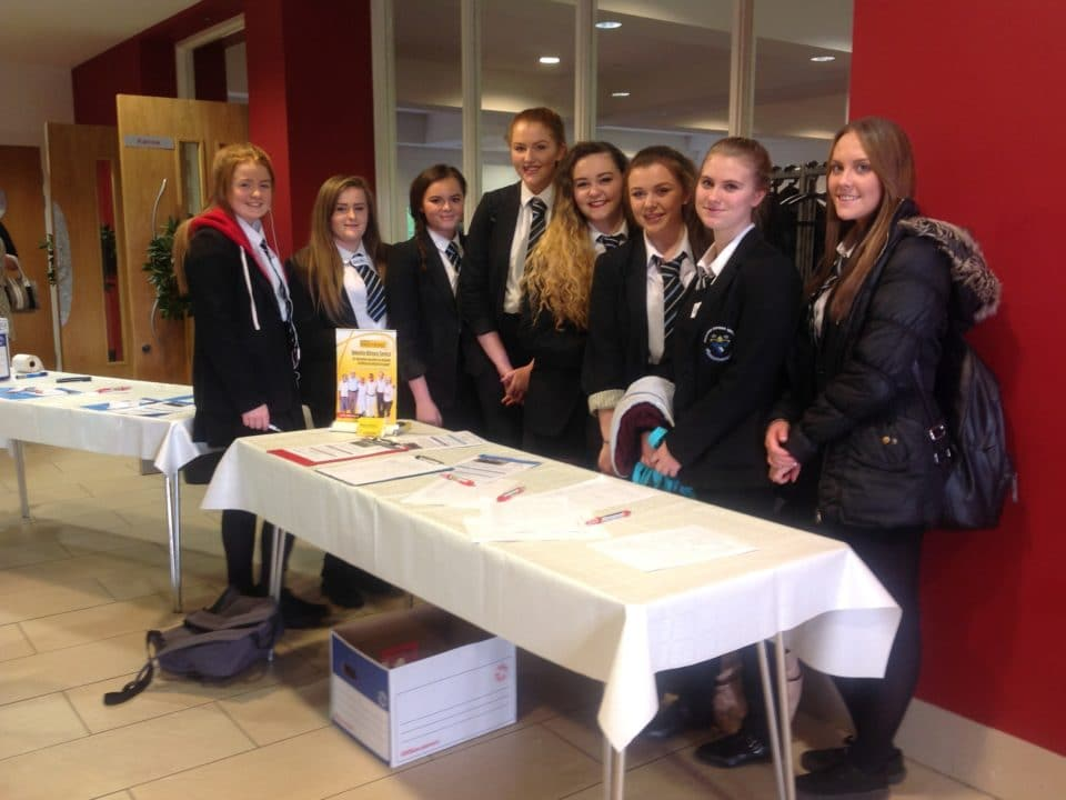 school pupils at an information stall