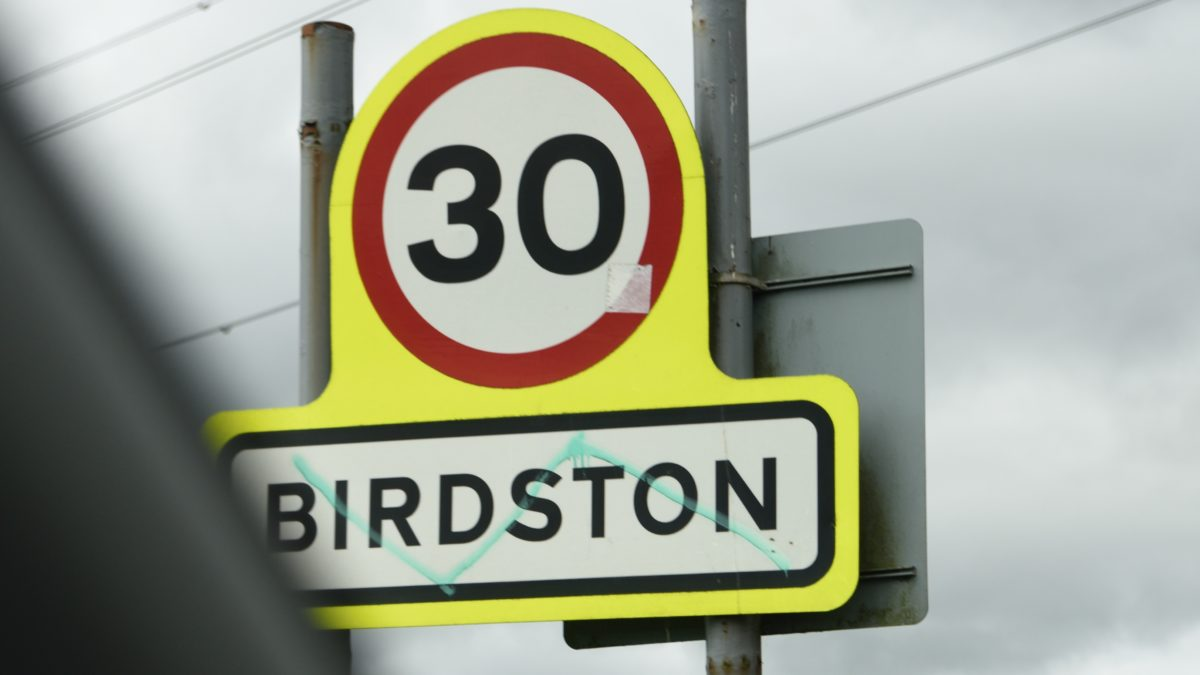 traffic sign displaying area of Birdston, is approaching